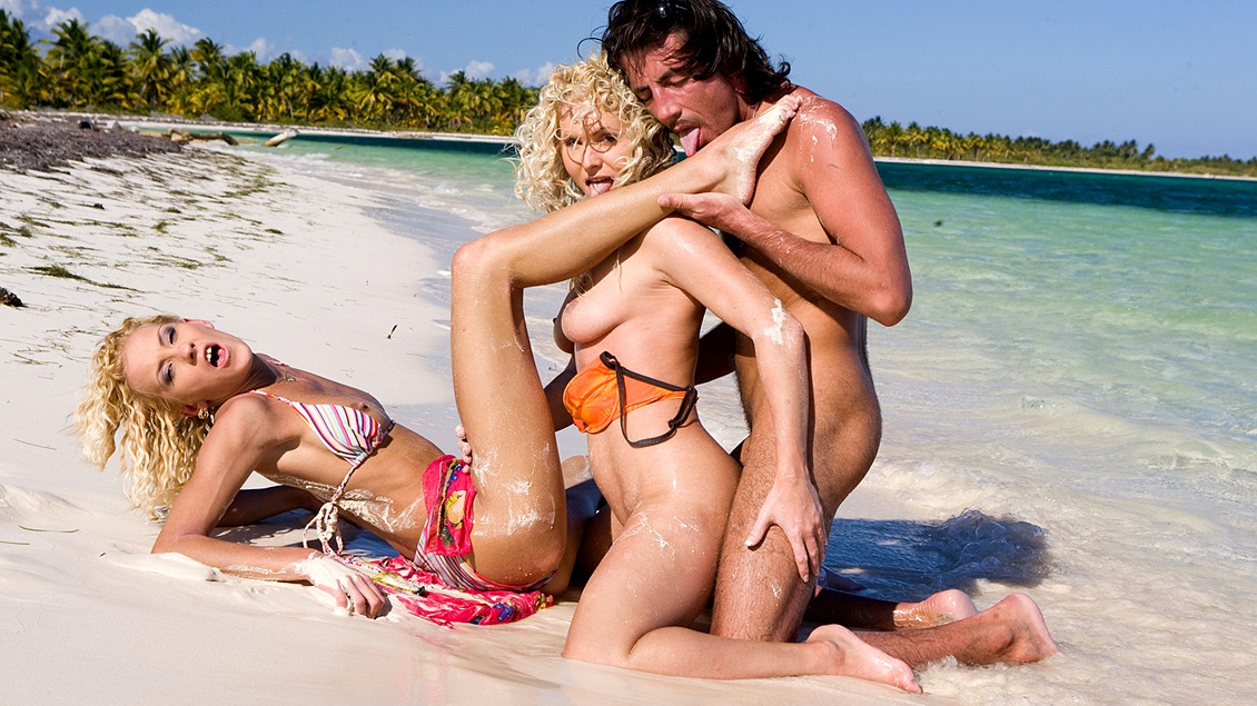 Two Blondes Perform Cross Ass to Mouth on an Empty Beach