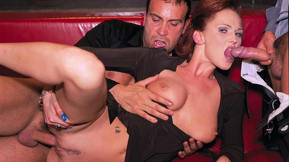 Sultry Redhead Donna Marie Works a Meat Pole While Others Watch
