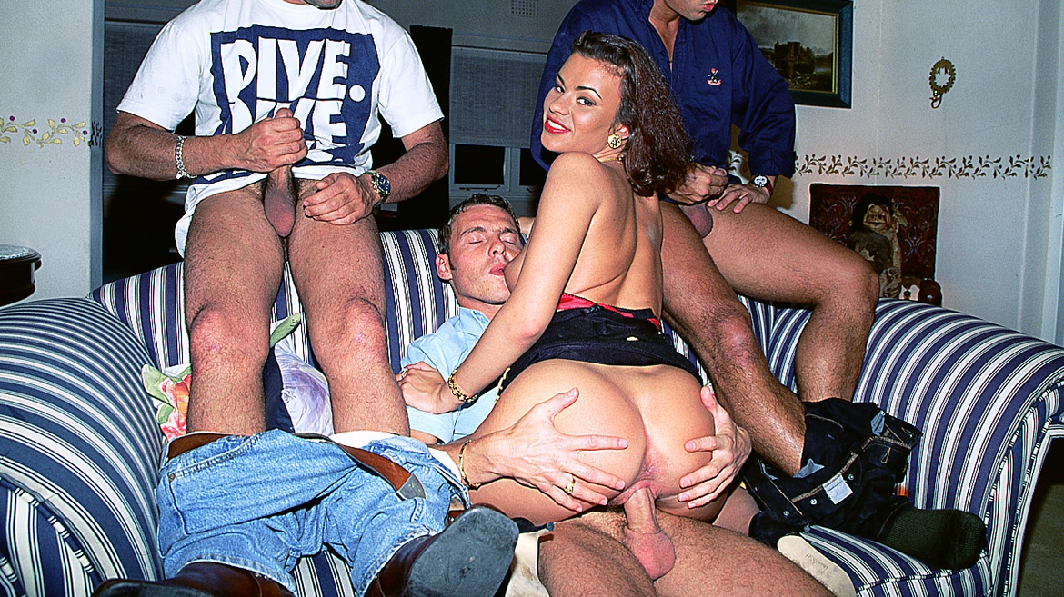 Miss Julia Takes on Three Hard Cocks in This Gangbang Scene