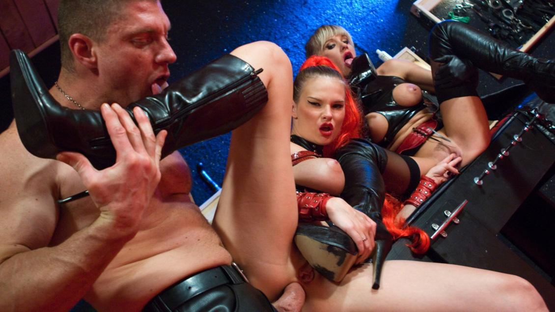 Natalli Di Angelo and Tarra White Lick Latex Boots in BDSM Threesome