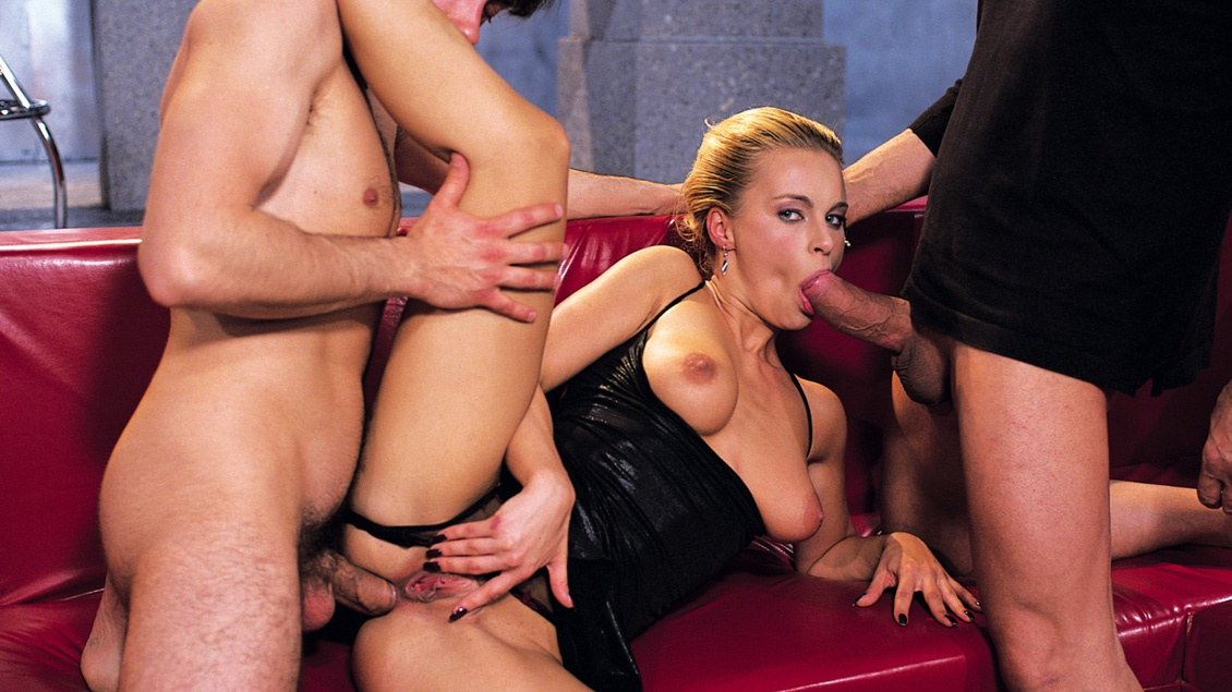 Nikki Sun Is Having Her Booty Penetrated While Giving a Blowjob 3 Way