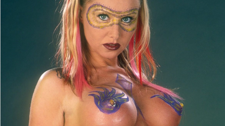 Lisa Sparkle and Sandra Iron Get Kinky Under UV Light